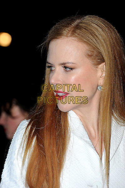 NICOLE KIDMAN .Attending the World Premiere of the film 'NINE' held at the Odeon cinema Leicester Square, London, England, UK,  3rd December 2009..portrait headshot red lipstick make-up profile white.CAP/IA.©Ian Allis/Capital Pictures.