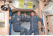 """Two Soyuz Taxi crewmembers, South African space flight participant Mark Shuttleworth (left) and Flight Engineer Roberto Vittori of the European Space Agency (ESA), are photographed in the Unity node on the International Space Station (ISS). Soyuz Taxi Commander Yuri Gidzenko, representing Rosaviakosmos, is out of frame. The """"taxi"""" crew arrived at the orbital outpost on April 27, 2002 at 2:56 a.m. (CDT) as the two vehicles flew over Central Asia. <br /> Credit: NASA via CNP"""