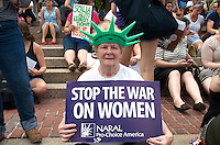 "Protest of Supreme Court decision in Hobby Lobby case exempting small businesses under religious freedom clause from providing birth control as part of Affordable Care Act ""Obamacare"" and decision eliminating buffer zones outside women's health clinics at City Hall Plaza Boston Massachusetts 7.8.14"