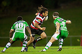 Tana Umaga makes a midfield run at Tomasi Cama and Doug Tietjens. ITM Cup rugby game between Counties Manukau and Manawatu played at Bayer Growers Stadium on Saturday August 21st 2010..Counties Manukau won 35 - 14 after leading 14 - 7 at halftime.