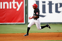 Edgar Corcino (21) of the Chattanooga Lookouts on his way to third base for a triple in the game against the Montgomery Biscuits on May 25, 2018 at AT&T Field in Chattanooga, Tennessee. (Andy Mitchell/Four Seam Images)