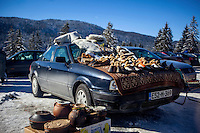 Local craft products displayed for sale on a car at the roadside in the mountains near the Igman plateau, one of the venues for the 1984 Winter Olympics.