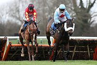 Betfred When Both Teams Score Handicap Hurdle (L) and Original Prankster ridden by Paddy Brennan jump the last in the Betfred When Both Teams Score Handicap Hurdle at Huntingdon Racecourse, Brampton, Cambridgeshire