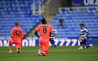 7th July 2020; Madejski Stadium, Reading, Berkshire, England; English Championship Football, Reading versus Huddersfield; Trevoh Chalobah of Huddersfield takes to one knell in support of BLM