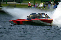 "Regates de Valleyfield, 6-8 July,2001 Salaberry de Valleyfield, Quebec, Canada.Copyright©F.Peirce Williams 2001.Jean Theoret, GP-7 ""Lotto Super 7/Casino de Montreal, Grand Prix class hydroplane..F. Peirce Williams .photography.P.O.Box 455  Eaton, OH 45320.p: 317.358.7326  e: fpwp@mac.com"
