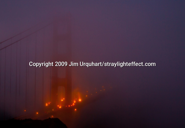 The Golden Gate Bridge shrouded in fog in San Francisco, California. Jim Urquhart/straylighteffect.com 7/26/09