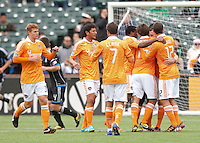 San Francisco, California - Saturday March 17, 2012: Dynamo teammates celebrate Brad Davis' Penalty Kick during the MLS match at AT&T Park. Houston Dynamo defeated San Jose Earthquakes  1-0