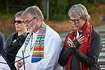 Three district superintendents of the Pacific Northwest conference of the United Methodist Church lead prayer outside the Federal Detention Center in Seatac, Washington, during a June 24 prayer vigil in support of immigrant parents inside the prison who've been separated from their children.