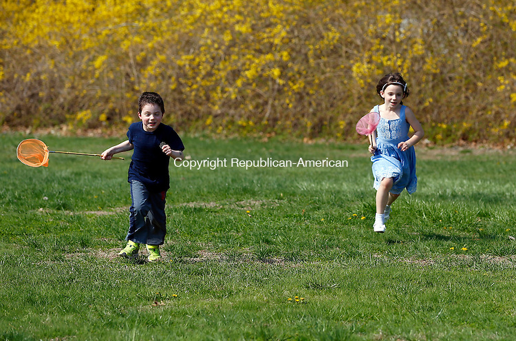 Woodbury, CT- 04 May 2015-050415CM01- Travis Jones, 6, left, and Caoilainn Brinkman, 7, students at Mitchell Elementary School look for farm friendly bugs outside the school in Woodbury on Monday.  The pair were among a group of students who were learning about farming from Diane Parmelee, education coordinator at Flanders Nature Center.  The six week course will cover baby chicks, bunnies, making butter, hands on wool craft, poultry management, goat-kids, bee pollinators and planting.    Christopher Massa Republican-American