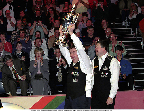 STEPHEN LEE lifts the trophy for England and celebrates winning the Snooker Nations Cup with john Parrot, The Hexagon, Reading, 000123. Photo: Glyn Kirk/Action Plus...2000.snooker ball player cup celebrate celebration joy