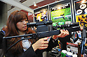 October 19, 2011, Tokyo, Japan - A non-lethal dithering laser gun is demonstrated during Risk Management Expo in Tokyo on Wednesday, October 19, 2011. Members of domestic and foreign law enforcement communities were among visitors to the annual security and safety trade show that covered the fields of safety, risk and crisis management, and security and crime prevention. (Photo by Natsuki Sakai/AFLO) [3615] -mis-