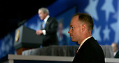 A Secret Service Agent watches as United States President George W. Bush speaks at the President's Dinner in Washington, DC on June 14, 2005.  <br /> Credit: Dennis Brack - Pool via CNP