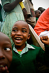 A student cheers during a volleyball game at the Hamomi Children's Centre in Nairobi, Kenya