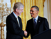 United States President Barack Obama shakes hands with National Institutes of Health (NIH) director Francis S. Collins during an event announcing the Administration's BRAIN (Brain Research through Advancing Innovative Neurotechnologies) Initiative in the East Room of the White House in Washington, D.C. on Tuesday, April 2, 2013..Credit: Molly Riley / Pool via CNP