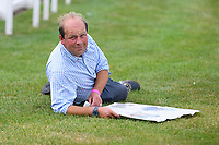 Trainer Harry Dunlop relaxes outside the Parade Ring during Horse Racing at Salisbury Racecourse on 13th August 2020