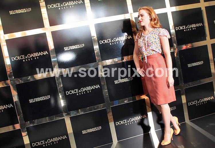 **ALL ROUND PICTURES FROM SOLARPIX.COM**.**NO UK NEWSPAPER PUBLICATION**.**UK MAGAZINE & SUPPLEMENT PUBLICATION ONLY** AND NO PUBLICATION IN AUSTRALIA, FRANCE, GERMANY, ITALY AND SCANDINAVIA** .Scarlett Johansson makes a personal appearance at Selfridges, Oxford Street, for Dolce & Gabana Make Up. London, UK. Friday July 31, 2009. ..This pic: Scarlett Johansson ..JOB REF: 9652 SFE       DATE: 31_07_2009.**MUST CREDIT SOLARPIX.COM OR DOUBLE FEE WILL BE CHARGED**.**MUST NOTIFY SOLARPIX OF ONLINE USAGE**.**CALL US ON: +34 952 811 768 or LOW RATE FROM UK 0844 617 7637**