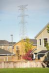 Suburban neighborhood and High tension power tower.