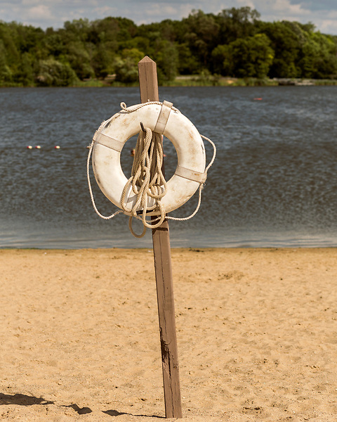 August 5, 2016. Flint, Michigan.<br />  A life preserver at Bluebell Beach, just upstream from the Flint city limits. <br />  In April 2014, the city of Flint switched its water source from the Detroit Water and Sewerage Department to using the Flint River in an effort to save money. When the switch occurred, the city failed to have corrosion control treatment in place for the new water. This brought about a leaching of lead from pipes into the water, increasing the lead content in the drinking water to levels far above legal limits. After independent sources brought this to light, the city admitted the water was unsafe and legal battles have ensued between resident and the local and state governments.