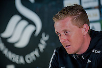 SWANSEA, WALES - APRIL 09: Garry Monk addresses the media during the Swansea City Press Conference at the Liberty Stadium on April 09, 2015 in Swansea, Wales.  (Photo by Athena Pictures)
