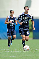 10 September 2011:  FIU's Roberto De Sousa (20) moves the ball upfield in the second half as the FIU Golden Panthers defeated the Stetson University Hatters, 3-2 in the second overtime period, at University Park Stadium in Miami, Florida.
