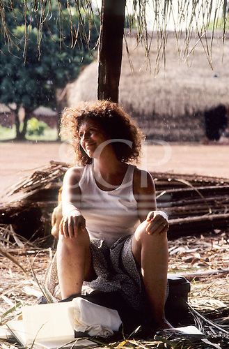 A - Ukre Village, Xingu, Brazil. Anita Roddick, the owner of Body Shop resting in the Kayapo village.