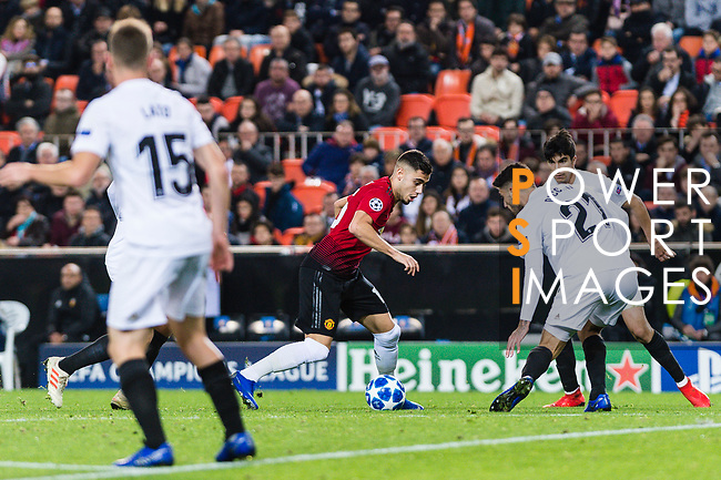 Andreas Pereira of Manchester United (C) in action against Cristiano Piccini of Valencia CF (R) during the UEFA Champions League 2018-19 match between Valencia CF and Manchester United at Estadio de Mestalla on December 12 2018 in Valencia, Spain. Photo by Maria Jose Segovia Carmona / Power Sport Images
