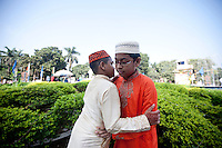 Children hug each other after they join the Eid-ul-Azha congregation in Dhaka, Bangladesh. Oct. 6, 2014