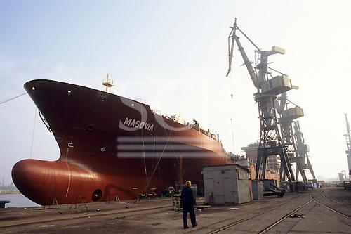 Gdansk, Poland. Shipyard; ocean going ship at the dockside.
