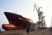 Gdansk, Poland. Shipyard; ocean going ship at the dockside.
