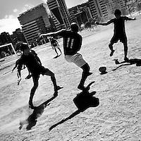 Ecuadorian men play football on a dirt football pitch in Parque La Carolina, a park in the central business district of Quito, Ecuador, 1 October 2014.