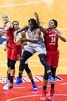 Washington, DC - Sept 17, 2017: Minnesota Lynx center Sylvia Fowles (34) fights for a rebound against Washington Mystics guard Elena Delle Donne (11) and Washington Mystics center Krystal Thomas (34) during playoff game between the Mystics and Lynx at the Verizon Center in Washington, DC. (Photo by Phil Peters/Media Images International)