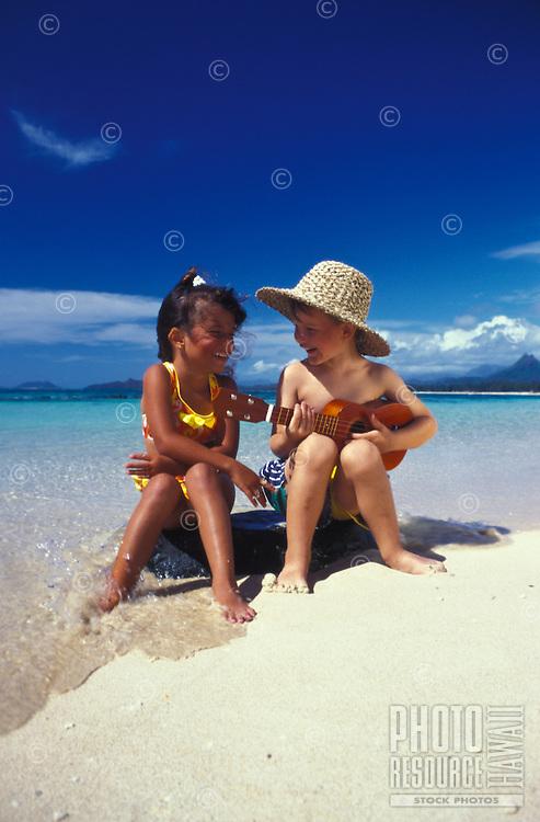 Boy in beach hat with ukulele serenades his friend