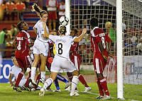Amy Rodriguez of United States heads the ball. The US Women's National Team defeated Haiti 5-0 during the CONCACAF Women's World Cup Qualifying tournament at Estadio Quintana Roo in Cancun, Mexico on October 28th, 2010.