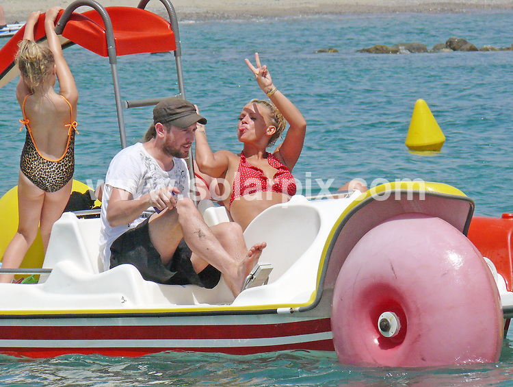 **ALL ROUND EXCLUSIVE PICTURES FROM SOLARPIX.COM**.**WORLDWIDE SYNDICATION RIGHTS**.Kerry Katona takes her two daughters Molly and Lilly-Sue for Pedalo ride on the beach Marbella in Spain today, joined by her ever present film crew. ..This pic: Kerry Katona takes a trip the beach with her kids.JOB REF: 11892 AB1       DATE: 12_08_2010.**MUST CREDIT SOLARPIX.COM OR DOUBLE FEE WILL BE CHARGED**.**MUST NOTIFY SOLARPIX OF ONLINE USAGE**.**CALL US ON: +34 952 811 768 or LOW RATE FROM UK 0844 617 7637**