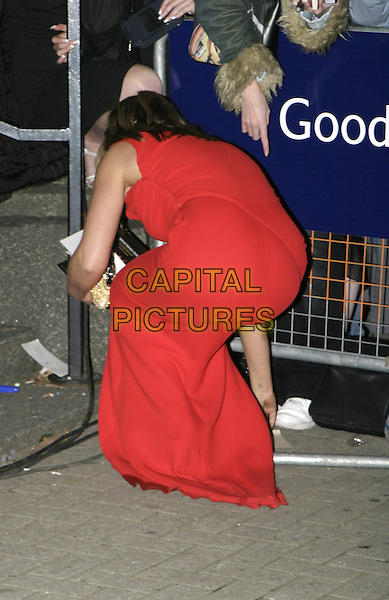 PATSY KENSIT.Leaving National Television Awards.October 26th, 2004.full length, back, behind, rear, bending over, gesture.www.capitalpictures.com.sales@capitalpictures.com.© Capital Pictures.