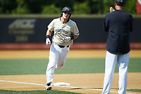 Bobby Seymour (3) of the Wake Forest Demon Deacons rounds third base after hitting a home run against the Virginia Cavaliers at David F. Couch Ballpark on May 19, 2018 in  Winston-Salem, North Carolina.  The Demon Deacons defeated the Cavaliers 18-12.  (Brian Westerholt/Four Seam Images)
