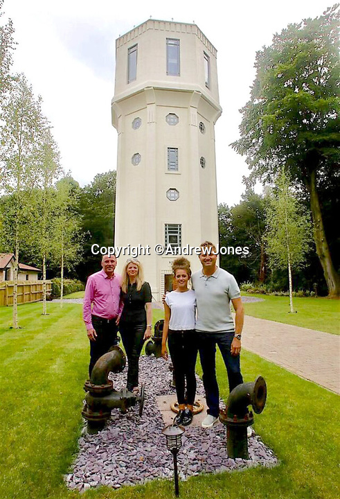 BNPS.co.uk (01202 558833)<br /> Pic:  AndrewJones/BNPS<br /> <br /> Andrew and Michele with daughter Mia and George Clarke.<br /> <br /> Seventh Heaven - Seven storey water tower in Cheshire that appered on George Clarkes The Restoration Man is for sale.<br /> <br /> A dilapidated old water tower which has been transformed into a stunning family home has gone on the market for £1,750,000.<br /> <br /> High Legh Water Tower, in Knutsford, Cheshire, was built in 1938 to improve the water supply to the area until it was decommissioned in 2007.<br /> <br /> The 85ft tall tower fell into disrepair before it was spotted by property developer Andrew Jones while playing a round of golf nearby.