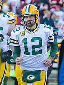 Green Bay Packers quarterback Aaron Rodgers (12) runs onto the field as his team is introduced prior to the NFC Wild Card game against the Washington Redskins at FedEx Field in Landover, Maryland on Sunday, January 10, 2016.<br /> Credit: Ron Sachs / CNP