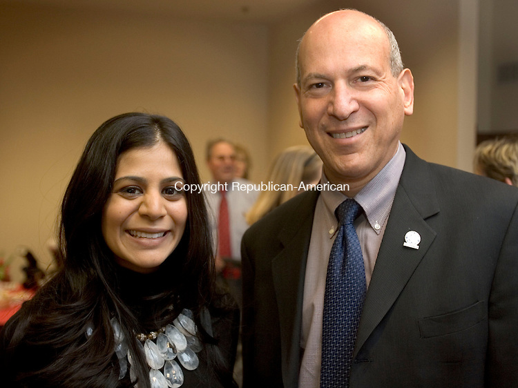 WATERBURY CT. 24 February 2014-022414SV12-From left, Shilpa Patel and Dr. Gil Lancaster of the American College of Cardiology attend a celebration of Saint Mary's participation in the American College of Cardiology's Patient Navigator Program at the hospital in Waterbury Monday.<br /> Steven Valenti Republican-American