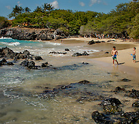Children playing at beach 69 along the Kohala coast in Hawaii