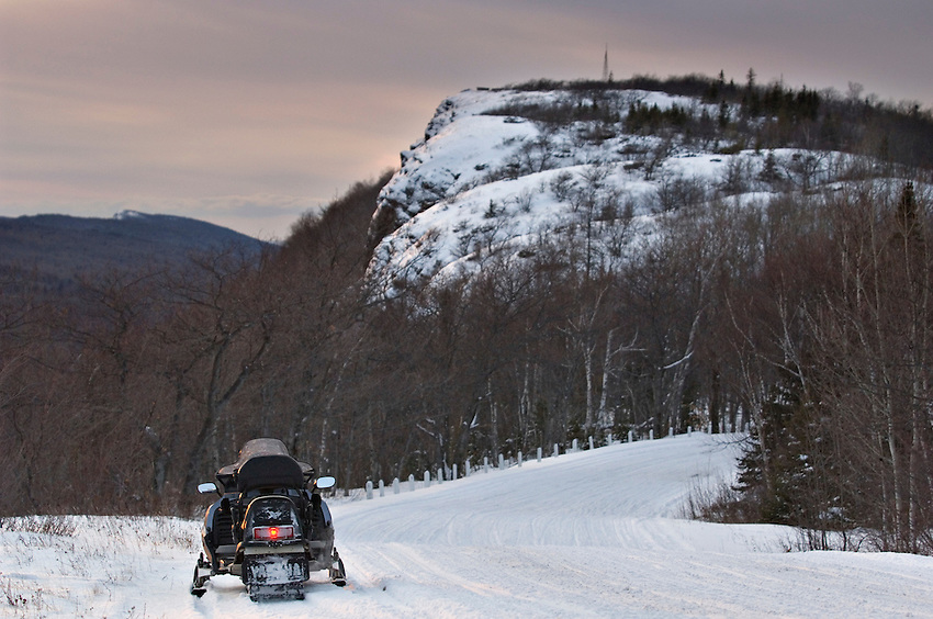 A snowmobile parked atop Brockway Mountain at dusk near Copper Harbor on the Keweenaw Peninsula of Michigan's Upper Peninsula.