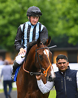 Winner of The Bathwick Car & Van Hire Novice Auction Stakes (Plus 10) Urban Icon ridden by Tom Marquand is led into the winners enclosure during Afternoon Racing at Salisbury Racecourse on 12th June 2018