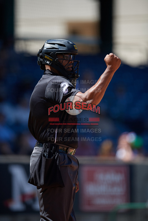 Umpire Jose Navas calls a strike during a Southern League game between the Jacksonville Jumbo Shrimp and Mississippi Braves on May 5, 2019 at Trustmark Park in Pearl, Mississippi.  Mississippi defeated Jacksonville 1-0 in ten innings.  (Mike Janes/Four Seam Images)