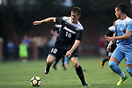 ELON, NC - AUGUST 25: Providence's Mac Steeves (18) and North Carolina's Alex Comsia (CAN) (4). The University of North Carolina Tar Heels hosted the Providence College Friars on August 25, 2017 at Rudd Field in Elon, NC in a Division I college soccer game. UNC won the game 4-2.