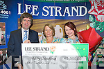 LEE STRAND WINNER: Mary Dowling, Ardfert, June's winner of the Lee Strand EUR5,000 with her daughter Anne-Marie, being presented with her cheque by Tim O'Keeffe (financial controller) on Wednesday, July 9th.   Copyright Kerry's Eye 2008