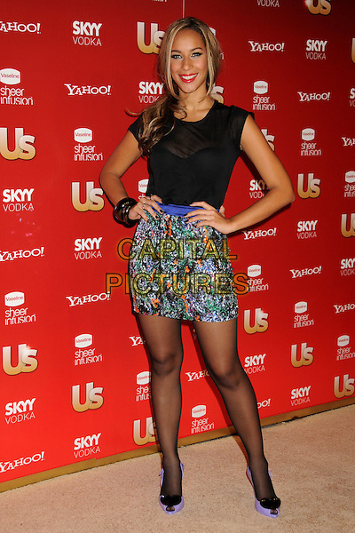 LEONA LEWIS .At US Weekly's Hot Hollywood Party 2009 held at Voyeur, West Hollywood, California, USA, .18th November 2009..full length black sheer see through top t-shirt blue pattern print mini skirt tights thru orange purple Vivienne Westwood peep toe hearts jelly shoes rubber bracelets hands on hips .CAP/ADM/BP.©Byron Purvis/AdMedia/Capital Pictures.