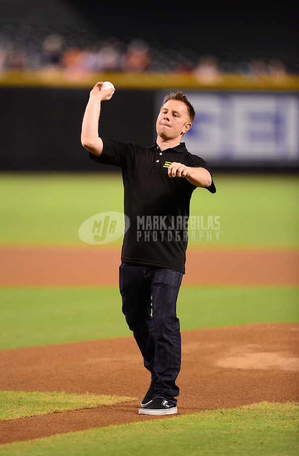 Aug. 29, 2012; Phoenix, AZ, USA: NASCAR driver Jason Leffler throws out the first pitch prior to the game between the Arizona Diamondbacks against the Cincinnati Reds at Chase Field. Mandatory Credit: Mark J. Rebilas-