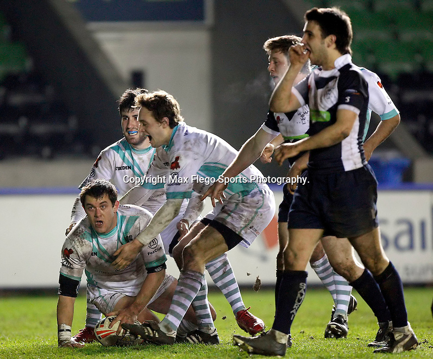 Cambridge players celebrate Ignacio Quintana try (L) during the 29th Pcubed Rugby League Varsity game between Oxford and Cambridge at the Twickenham Stoop on Thursday March 5, 2009