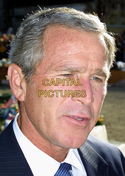 PRESIDENT GEORGE BUSH.at Ground Zero one year on from the September 11 tragedy.www.capitalpictures.com.©Capital Pictures.politics