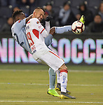 Gerso Fernandes of Sporting KC (left) and Rodrigo Salinas of Toluca vie for the ball during their CONCACAF Champions League game on February 21, 2019 at Children's Mercy Park in Kansas City, KS.<br /> Tim VIZER/Agence France-Presse